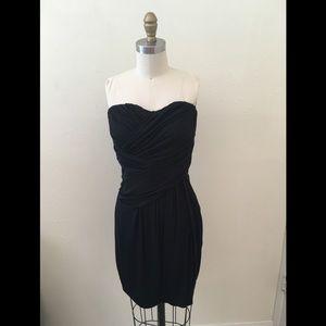 Beautifully draped body con black strapless dress